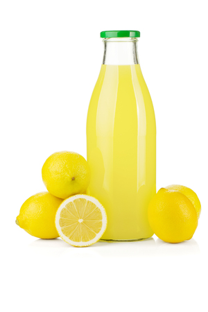 Bottle of lemon juice and fresh lemons. Isolated on white background Imagens