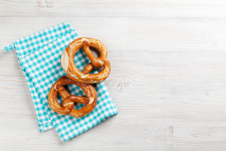 Pretzel. Beer snacks on wooden table. Top view with copy space Stock Photo