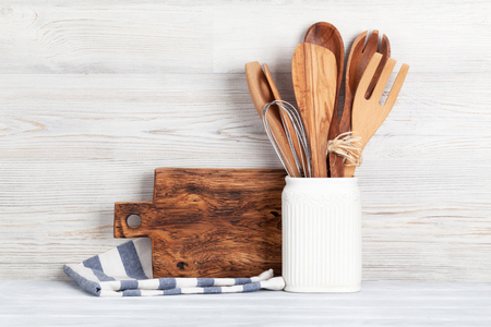 old items: Kitchen utensils in front of wooden wall with space for your text