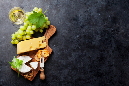 White wine, grape, bread and cheese on stone table. Top view with copy space Zdjęcie Seryjne