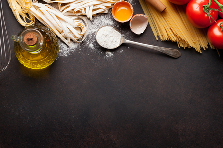 cooking oil: Pasta cooking ingredients on wooden kitchen table. Top view with space for your text