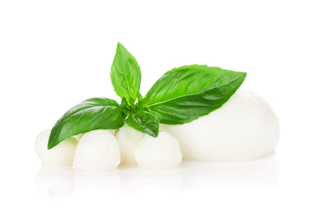 Mozzarella cheese and basil herb leaves. Isolated on white background Banco de Imagens - 80475753