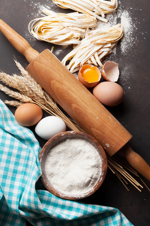 Pasta cooking ingredients on wooden kitchen table. Top view Stock Photo