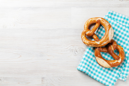 Pretzel. Beer snacks on wooden table. Top view with copy space Reklamní fotografie