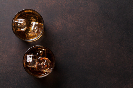 Whiskey with ice. Top view with copy space Foto de archivo