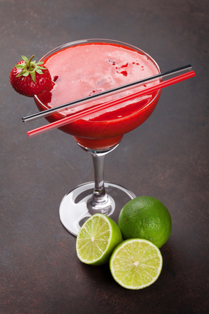 Strawberry margarita cocktail on dark stone table