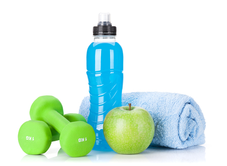 Dumbbells, towel, apple and water bottle. Fitness and health. Isolated on white background Stock fotó