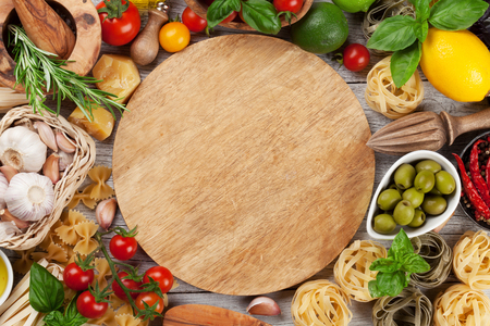 Italian food. Pasta ingredients on wooden table. Top view with space for your text Stock Photo