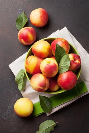 Fresh ripe peaches on stone table. Top view