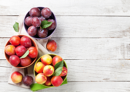 Fresh ripe peaches on wooden table. Top view with space for your text