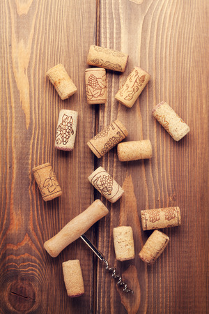 Wine corks over rustic wooden table background