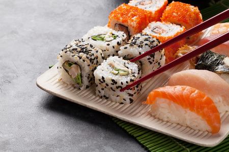Sushi and maki set on stone table Stock Photo