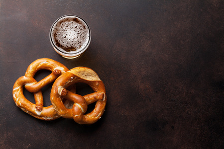 pretzel: Lager beer and pretzel on stone table. Top view with copy space