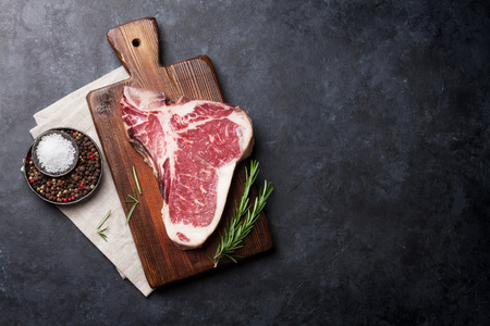 Raw T-bone steak cooking on stone table. Top view with copy space Stock fotó - 86431916