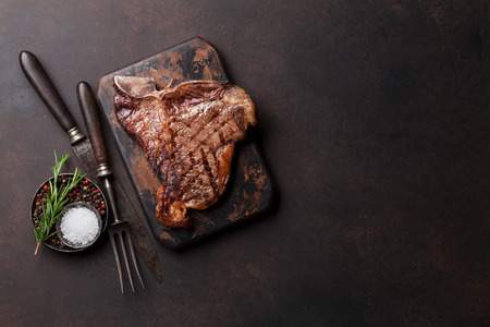 Grilled T-bone steak on stone table. Top view with copy space Stock fotó