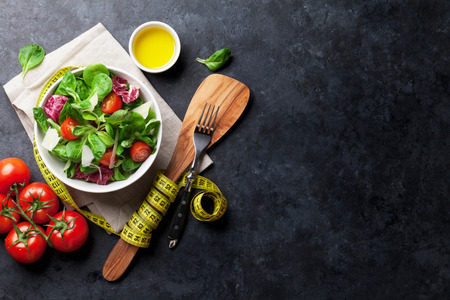 Healthy salad bowl on stone table. Top view with copy space Stock Photo - 86941844