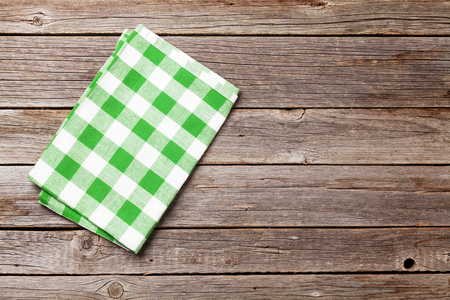 Kitchen towel on wooden cooking table. Top view with copy space