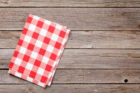 Kitchen towel on wooden cooking table. Top view with copy space Фото со стока - 87336398