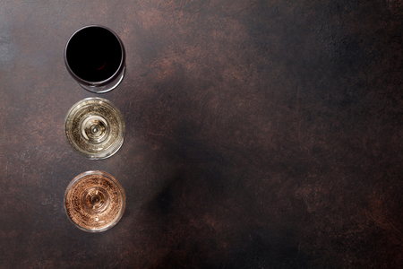 Wine glasses on stone table. Top view with space for your text