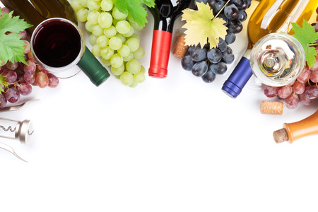Wine and grapes. Isolated on white background. Top view with space for your text