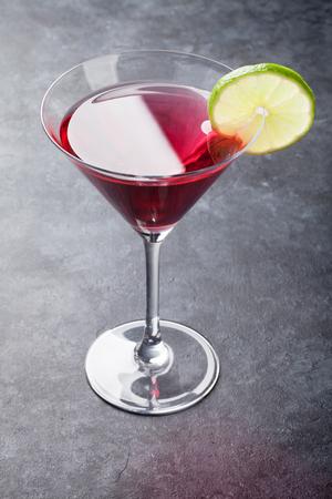 Cosmopolitan cocktail on dark stone table