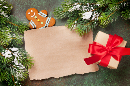 todo list: Piece of paper for christmas wishes, gift box and snow xmas tree. Top view with space for your text
