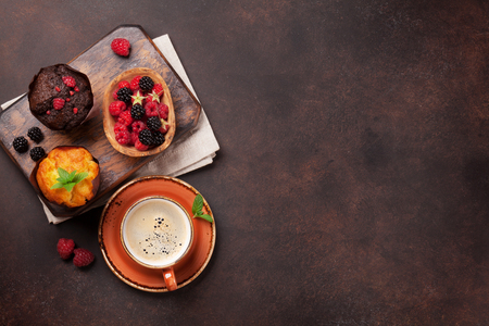 Muffins with berries and coffee. Top view with space for your text