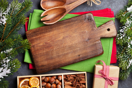 Christmas food decor and cooking utensils. Xmas cooking table and fir tree. Top view