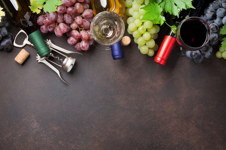 Wine glasses and grapes on stone table. Top view with space for your text