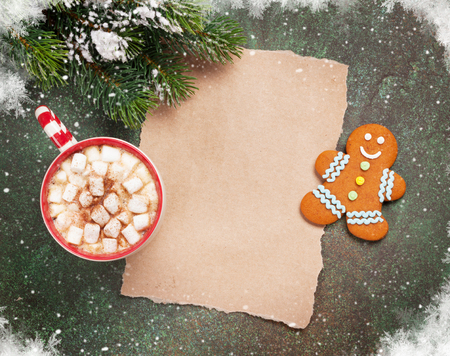 todo list: Piece of paper for christmas wishes, coffee cup and snow xmas tree. Top view with space for your text Stock Photo