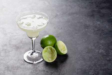 Margarita cocktail on dark stone table. With space for your text