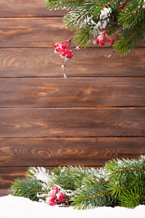 Christmas greeting card with xmas tree in front of wooden wall. With space