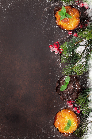 Christmas greeting card with xmas tree and muffins. Top view with space for your greetings
