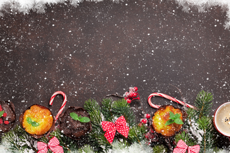 Christmas greeting card with xmas tree, muffins and coffee. Top view with space for your greetings