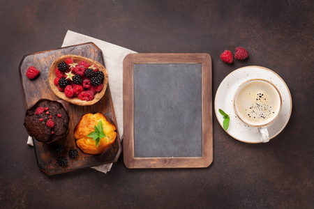 Muffins with berries and coffee. Top view with space for your text Stok Fotoğraf - 89448108