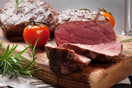 Grilled fillet steaks on cutting board Stok Fotoğraf