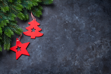Christmas fir tree and decor over stone background. Top view with copy space for your greetings Stock Photo