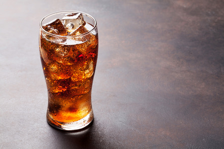 Cola glass with ice cubes with copy space