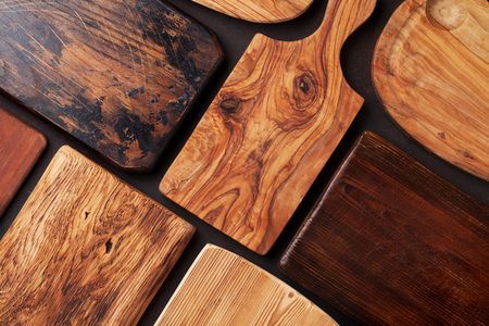 Various cutting boards on stone table. Cooking utensils. Top view