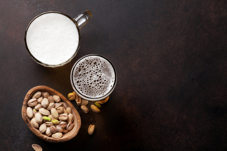 Lager beer and nuts on stone table. Top view with copy space Stock Photo