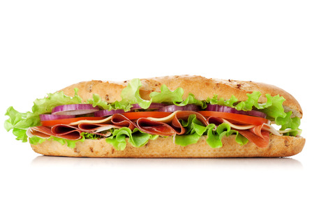Long sandwich with ham, cheese, tomatoes, red onion and lettuce. Isolated on white. Another angle available Фото со стока