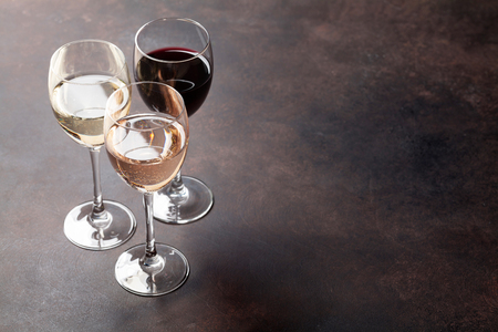Wine glasses on stone table. With space for your text