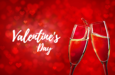 Happy Valentines Day red hearts background and two champagne glasses