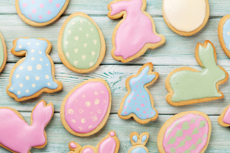 Easter gingerbread cookies on wooden table. Eggs and rabbits. Top view Stock Photo