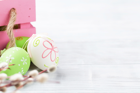 Easter eggs in box on wooden table. With space for your greetings Stock Photo