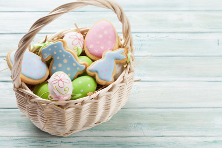 Easter gingerbread cookies on wooden table. Eggs and rabbits. With space for your greetings Stock Photo