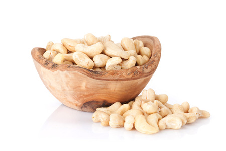 Cashew nuts in bowl. Isolated on white background Banco de Imagens