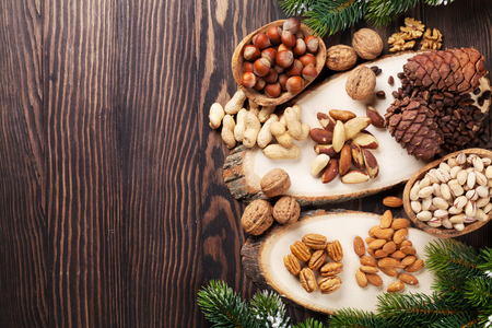 Various nuts on wooden table. Top view with copy space