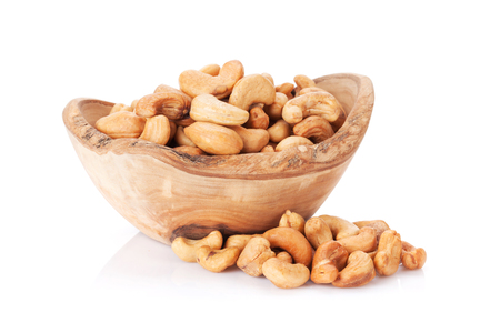 Cashew nuts in bowl. Isolated on white background
