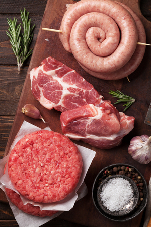 Raw meat, cutlet and sausages. Top view Stock Photo